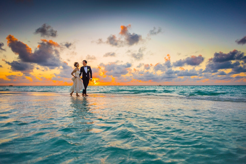 bridal couple walking on beach
