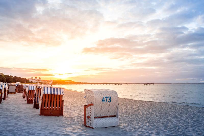 beach huts on beach at dawn germany