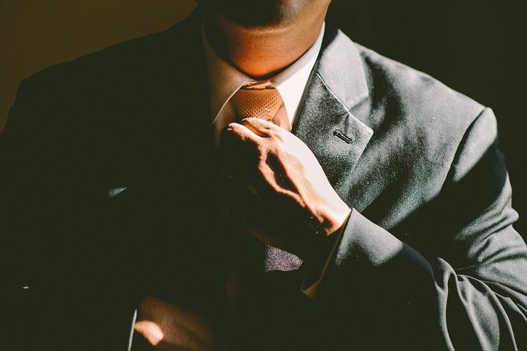 man-straightening-tie
