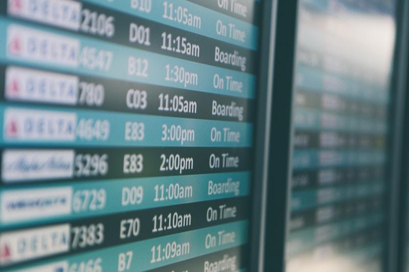 shot of airport flight information board