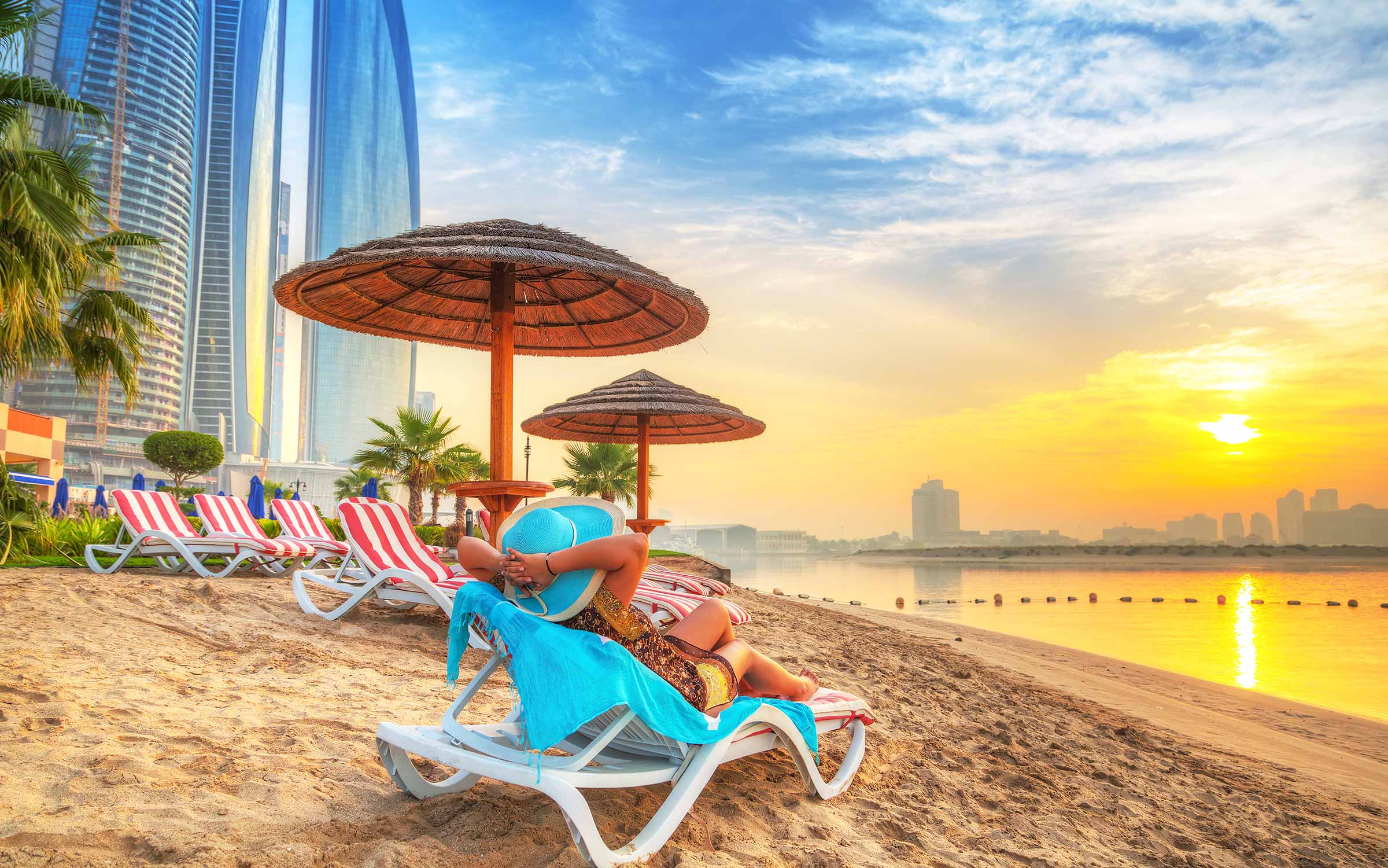 woman sun lounger UAE beach