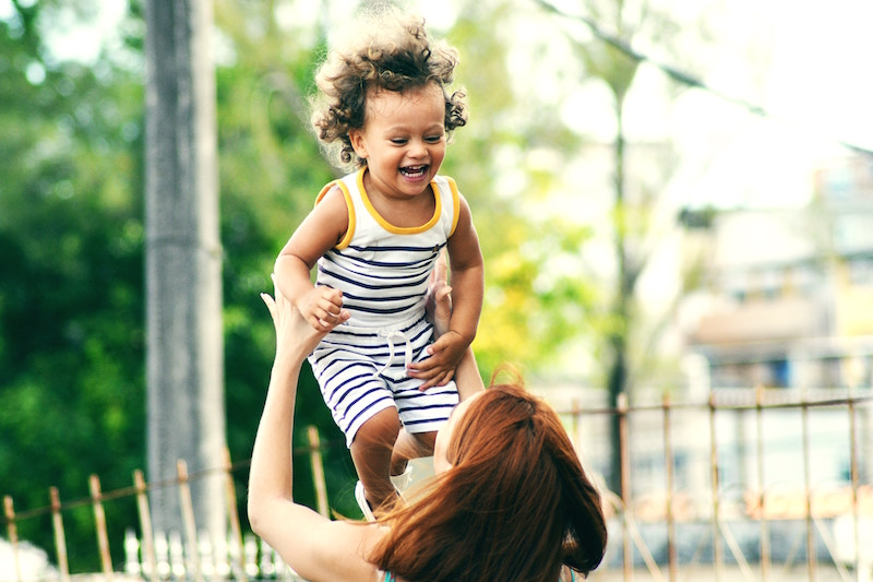 child laughing in air